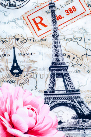 Texture, background. Fabric cotton bed linen. Eifel. With a picture of Paris, rose flower, city maps Paris Stock Photo