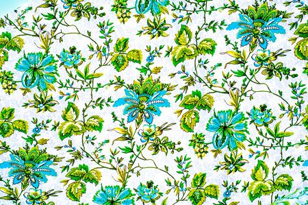 polyester: Texture, background. textiles. cotton cloth. linens, flowers pattern on a beige background, drawing on fabric Stock Photo