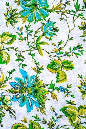linens: Texture, background. textiles. cotton cloth. linens, flowers pattern on a beige background, drawing on fabric Stock Photo