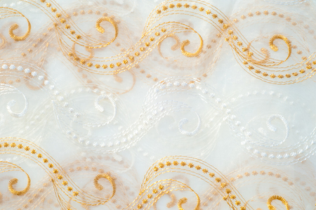 airy texture: Texture, background. Tulle white with gold lines, sequins Stock Photo