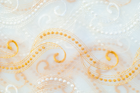 Texture, background. Tulle white with gold lines, sequins Stock Photo