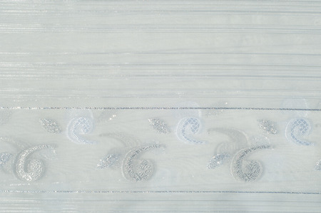 veils: Tulle, organza, white, with a pattern of flowers. a soft, fine silk, cotton, or nylon material like net, used for making veils and dresses.
