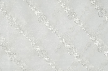 organza: Texture, background. Tulle, organza, Cream-colored, patterned balls Stock Photo