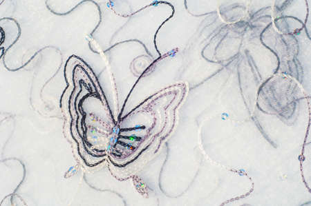 organza: Texture, background. Tulle, organza. Beautiful patterns with butterflies Stock Photo