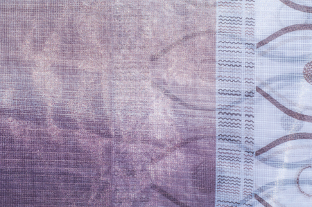 veils: Tulle, organza, white, purple flowers a soft, fine silk, cotton, or nylon material like net, used for making veils and dresses.