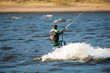 kiteboarding: October 1, 2015 the river Kama, Tatarstan, Russia. Kite - is not just a fashionable entertainment, its your new way of life Editorial