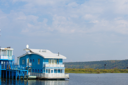 house float on water: Houseboat. Photographed on the river