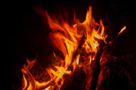 wood burning: fire burning fire. Fire burning in the night. crest of flame on burning wood.blaze fire flame texture background Stock Photo