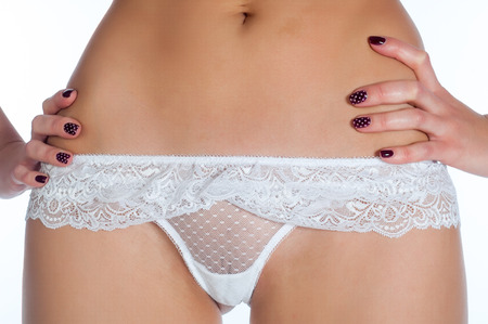 sexy woman nude: Girl in white panties. young woman body with cotton panties isolated on white background close-up.