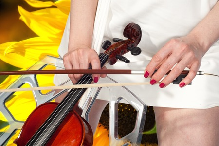 solo violinist: Girl with violin. Music. Beautiful girl with violin. Beautiful young girl with violin on bright background. a stringed musical instrument of treble pitch, played with a horsehair bow.