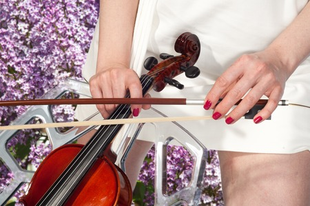 fingering: Girl with violin. Music. Beautiful girl with violin. Beautiful young girl with violin on bright background. a stringed musical instrument of treble pitch, played with a horsehair bow.