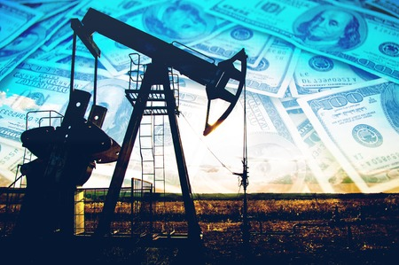 black money: oil pump. Oil industry equipment. filtered picture of oil pump jack. Oil and gas industry. Work of oil pump jack on a oil field. Stock Photo
