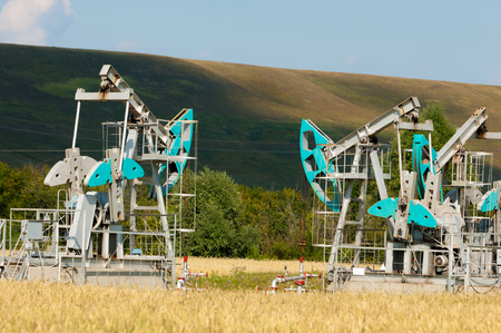 chink: oil pump. Oil industry equipment. filtered picture of oil pump jack. Oil and gas industry. Work of oil pump jack on a oil field. Stock Photo