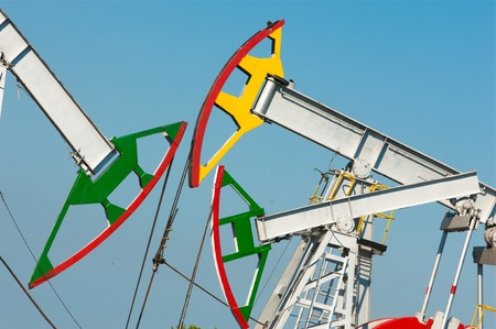 oil pump. Oil industry equipment. filtered picture of oil pump jack. Oil and gas industry. Work of oil pump jack on a oil field. Stock Photo