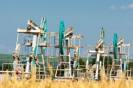oil and gas industry: oil pump. Oil industry equipment. filtered picture of oil pump jack. Oil and gas industry. Work of oil pump jack on a oil field. Stock Photo