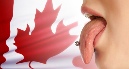 contributing: Tongue. The body in the mouth, which is the organ of taste, while also contributing to the formation of human speech sounds. Canadian flag