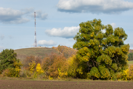 gprs: autumn yellow trees foothills. telephone relay tower Stock Photo