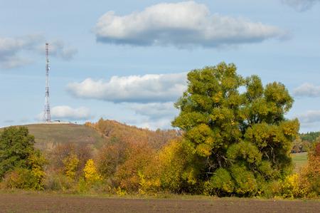 carrera de relevos: autumn yellow trees foothills. telephone relay tower Foto de archivo