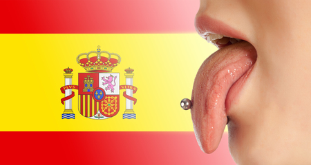 contributing: Tongue. The body in the mouth, which is the organ of taste, while also contributing to the formation of human speech sounds. Spanish flag Stock Photo