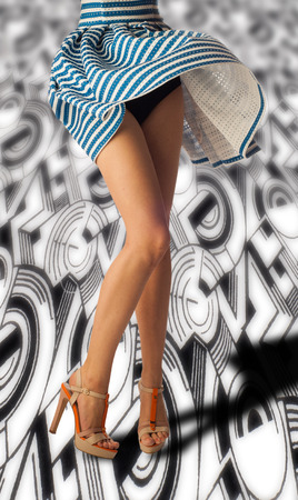 long feet: feet, the wind picked up the dress. Cheerful young woman with sexy legs and striped dress. Long legs woman. Depilation