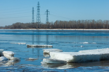 snow break: River With Broken Ice. energy pillars.  ice hummocks on the river in spring. landscape close-up ice drift on the river in the spring on a sunny day Stock Photo