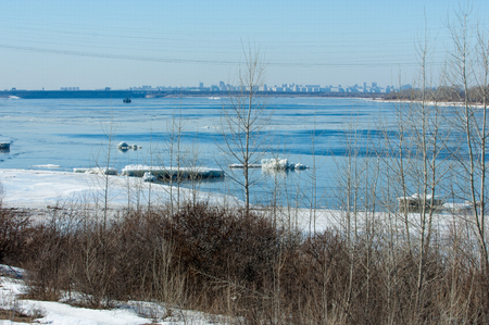 snow break: River With Broken Ice. ice hummocks on the river in spring. landscape close-up ice drift on the river in the spring on a sunny day Stock Photo