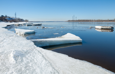 crevasse: River With Broken Ice.   ice hummocks on the river in spring. landscape close-up ice drift on the river in the spring on a sunny day