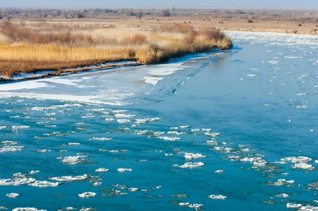 snow break: first frost formation of ice on the river. Ili Kazakhstan. Kapchagai Bakanas Stock Photo