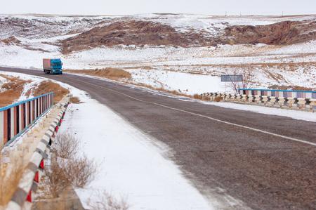 muddy tracks: winter road in the desert