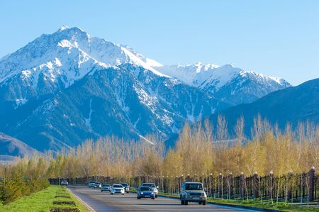 tien shan: 10, 03, 2015 Almaty, Kazakhstan, Street Al Farabi, Tien Shan Mountains, Early Spring. Editorial