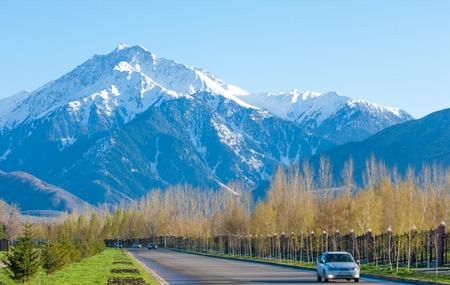 tien shan: 10, 03, 2015 Almaty, Kazakhstan, Street Al Farabi, Tien Shan Mountains, Early Spring. Stock Photo
