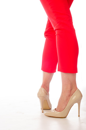 red pants: Legs, red pants, beige high-heeled shoes Stock Photo