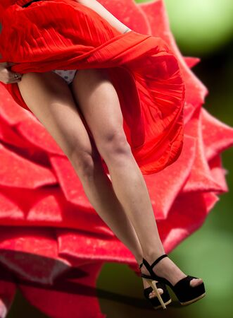 womanlike: Legs, red pants, black high-heeled shoes, red dress, the wind picked up the dress visible panties, ??? Stock Photo