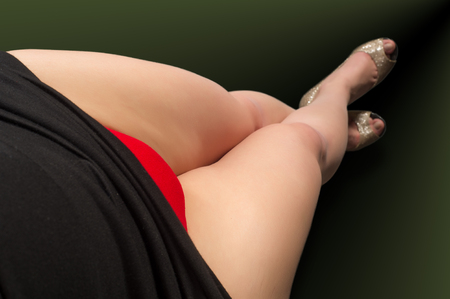Legs, red pants, beige high-heeled shoes Stock Photo