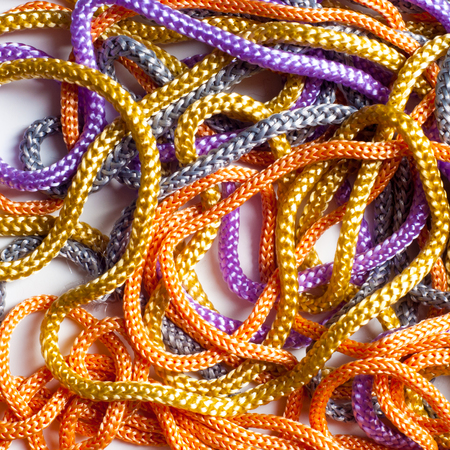 shoelaces: laces texture. wo lined boot laces on white background.  laces of different color isolated on white. Shoelaces. Multicolored shoelaces background
