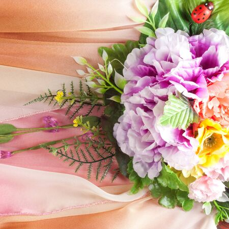 inlaid: Pink fabric inlaid flowers. texture. Photographed in the studio