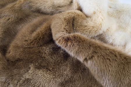 Textur, Hintergrund. Nerz Pelz. Nerzmantel. Goldfarbe Nerzpelzes. ein kleines, semiaquatic, stoatlike Tiereingeborener nach Nordamerika und Eurasien. Der amerikanische Nerz ist bekannt für seine Pelz weit bewirtschaftet.