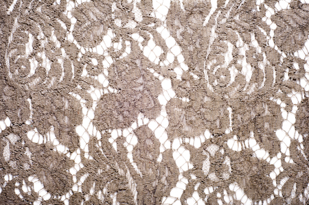 garments: texture lace. a fine open fabric, typically one of cotton or silk, made by looping, twisting, or knitting thread in patterns and used especially for trimming garments. Stock Photo