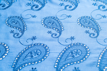 typically: texture lace. a fine open fabric, typically one of cotton or silk, made by looping, twisting, or knitting thread in patterns and used especially for trimming garments. Stock Photo