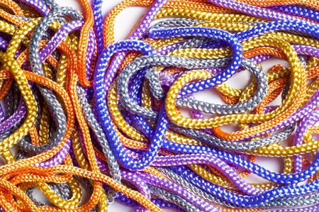 end of rainbow: laces texture. wo lined boot laces on white background.  laces of different color isolated on white. Shoelaces. Multicolored shoelaces background