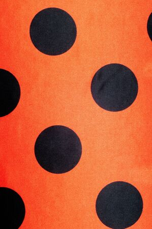 lunares rojos: Fabric red polka dots, textile, cloth, fabric, material, texture. of or relating to fabric or weaving. Foto de archivo