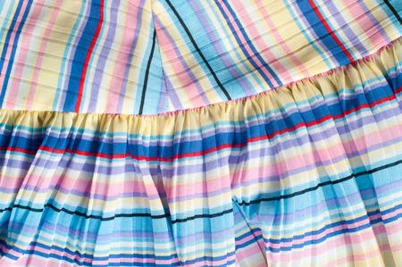 gauzy: Pleated fabric. Sinii yellow red white stripes texture. Photography Studio
