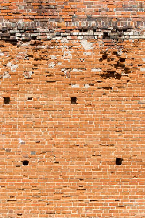 Texture, background. Brick wall. Fragment of Venetian old brick wall as background. Red brick wall texture background. Old brick wall texture background