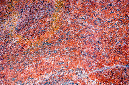 Texture, background. granite. a very hard, granular, crystalline, igneous rock consisting mainly of quartz, mica, and feldspar and often used as a building stone.