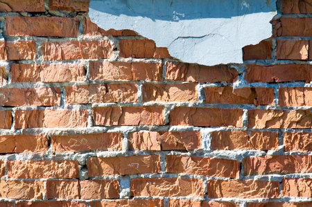 Texture, background. brick old plaster.  Brick old wall texture for background. background texture from brick wall with cracked plaster