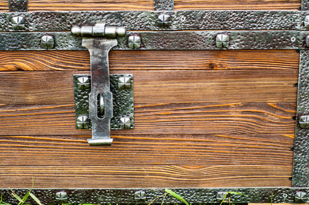 chest buckle. Macro detail of a wooden box metal latch. wooden box latch. close-up of the treasure chest