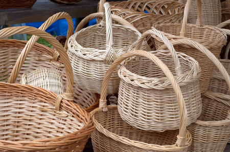 Wicker is a material made of plant stalks, branches or shoots formed by a kind of weaving into a rigid material, basket, pannier, car, chip basket, corf, nacelle Stock Photo