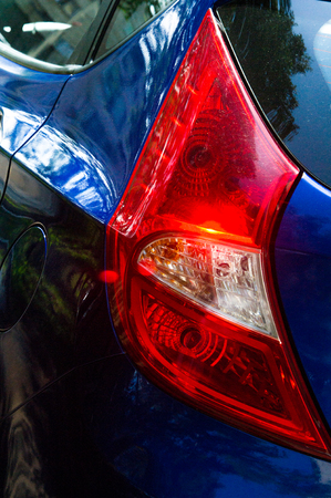 taillight: The texture of the car.