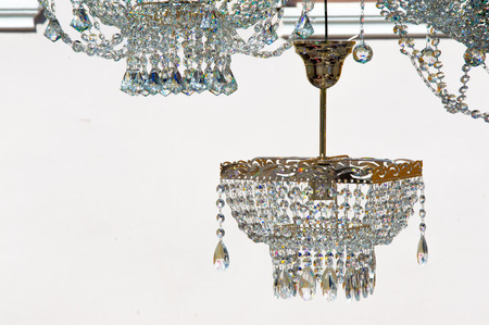 homogeneous: crystal chandeliers. a piece of a homogeneous solid substance having a natural geometrically regular form with symmetrically arranged plane faces.