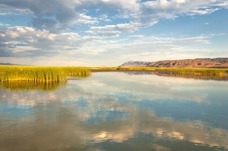 steppe summer. Turgai gate. Turgai save. National Park Altyn Emel Kazakhstan. Filling the river Ili Stock Photo